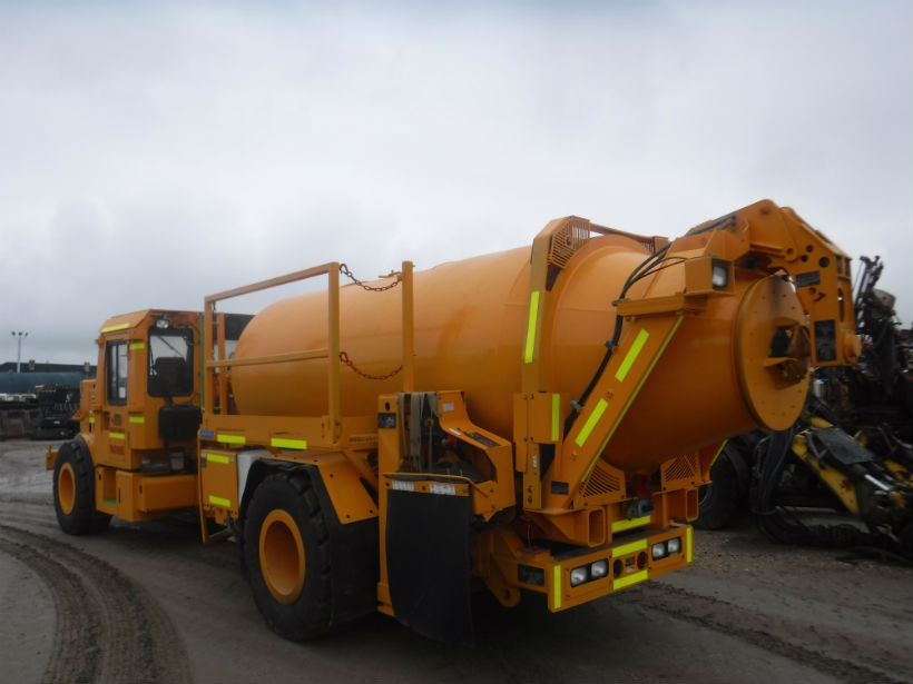 orange mining equipment vehicle concrete mixer